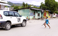 """Boy with Gun & UN"" Timor Leste - ""Winner of the 2014 International Loupe Award for Photojournalism"""